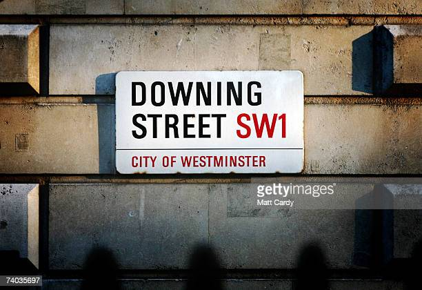 The street sign for Downing Street the historic home and office to the British Prime Minister on the eve of the 10th anniversary of Tony Blair's...