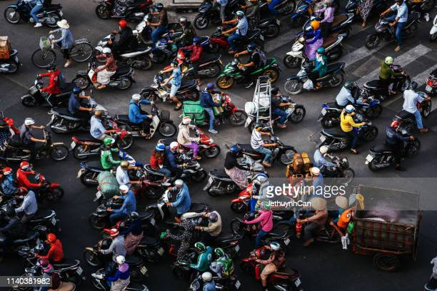 the streets are very crowded in rush hours with many motobikes in the city - vietnam stock pictures, royalty-free photos & images