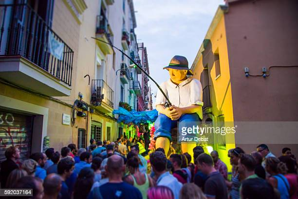 the streets of gracia in the barcelona city decorated for his festivity, compete each other to become the most beautiful street, this traditional festivity has become a popular travel destination on summer. - vanguardians stock pictures, royalty-free photos & images