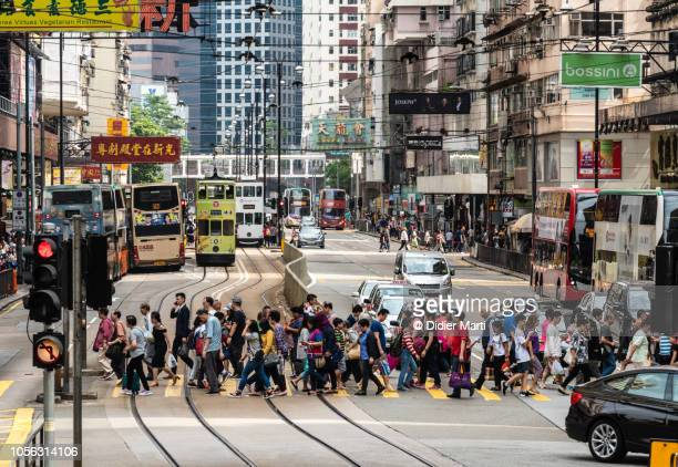 the streets of north point in hong kong - road signal stock pictures, royalty-free photos & images