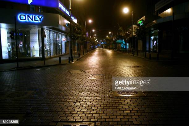 The streets remain empty at night in the alHamra shopping district after fighting broke out between Shiite Hezbollah forces and Sunni Muslims May 10...