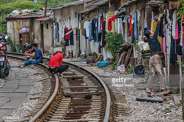 The stretch of railway track that leads from Hanoi station, over Long Bien bridge and out to Sapa in the north runs through a heavily populated...
