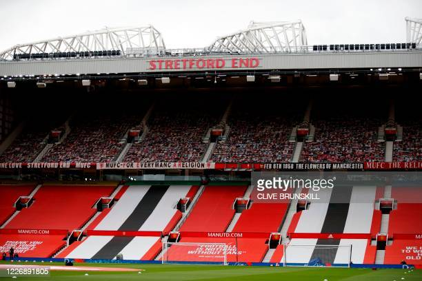 The Stretford End upper tiers filled with fan pictures is seen ahead of the English Premier League football match between Manchester United and...