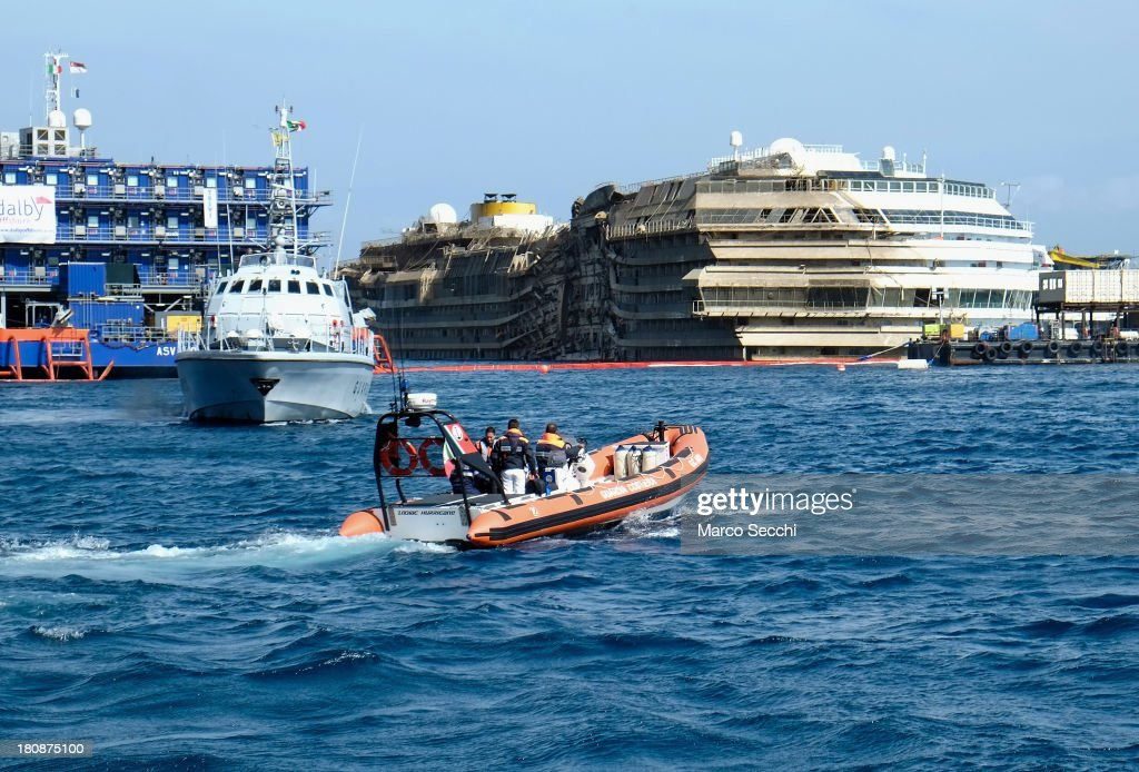 The stricken Costa Concordia is seen upright after the parbuckling operation was succesfully completed around 4 am on September 17, 2013 in Isola del Giglio, Italy. Work began yesterday to right the stricken Costa Concordia vessel, which sank on January 12, 2012. It will now be towed away and scrapped. The procedure, known as parbuckling, has never been carried out on a vessel as large as Costa Concordia before.