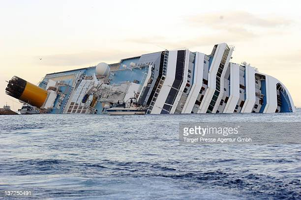 The stricken cruise liner Costa Concordia on January 17 2012 in Giglio Porto Italy More than four thousand people were on board when the ship hit...