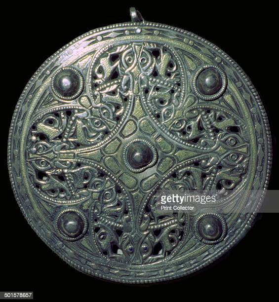 The Strickland Brooch AngloSaxon mid9th century Plain gold panels with a pattern of doglike animals with collars deeply carved to form an openwork...