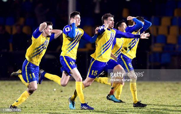 The Strikers celebrate victory during the FFA Cup Round of 32 match between the Brisbane Strikers and Wellington Phoenix at Perry Park on August 07,...