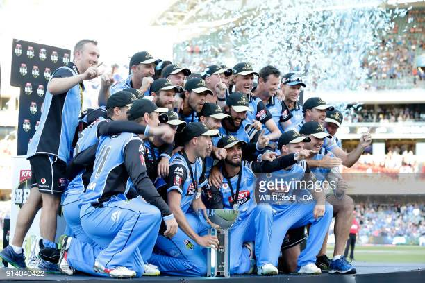 The Strikers celebrate with the trophy after winning the Big Bash League Final match between the Adelaide Strikers and the Hobart Hurricanes at...