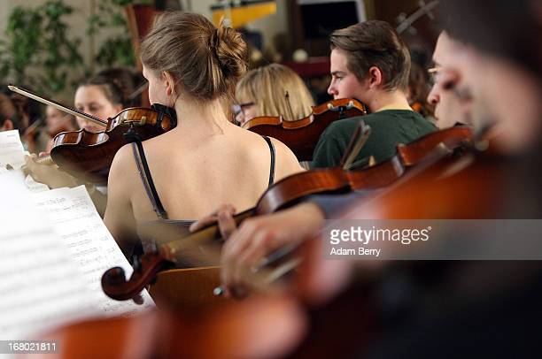 The string section of the ORSO Rock Symphony Orchestra rehearses for the ORSO RockSymphonyNight in the Evangelische PhilippusNathanael...