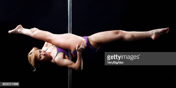 the strong and graceful young girl performing acrobatic exercises on pylon - ukraine stock photos and pictures