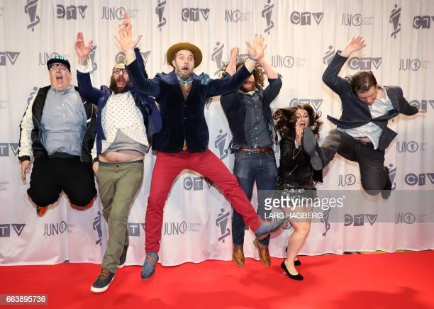 The Strumbellas celebrate with their trophies during the JUNO awards at the Canadian Tire Centre in Ottawa Ontario on April 2 2017 / AFP PHOTO / Lars...