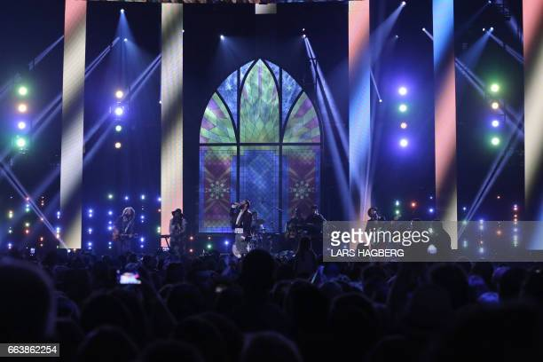 The Strumbellas perform during the JUNO awards show at the Canadian Tire Centre in Ottawa Ontario on April 2 2017 / AFP PHOTO / Lars Hagberg