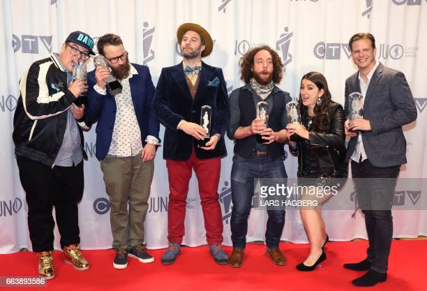 The Strumbellas pose for pictures with their trophies during the JUNO awards at the Canadian Tire Centre in Ottawa Ontario on April 2 2017 / AFP...