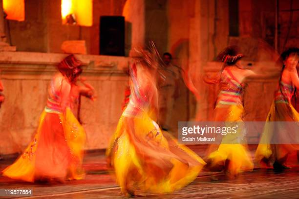 The student dance troupe of Shanghai Normal University performs at the Eastern Amphitheatre during the Jerash Festival on July 21 2011 in Jerash...