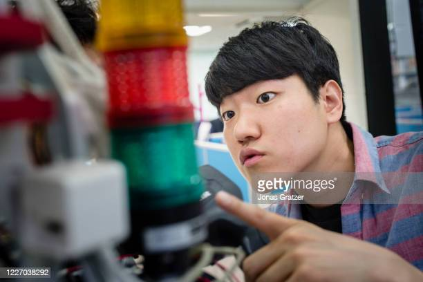 The student hyobin jung is looking for an error at a robot in the laboratory at kaist university in south korea. In South Korea robots are playing an...
