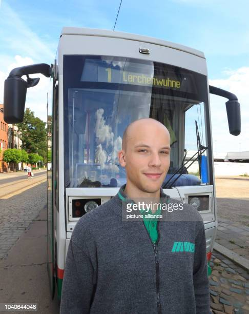 The student Malte Ahrens is pictured in front of a tram in Magdeburg Germany 22 August 2014 The transport services of Magdeburg GmbH currently...