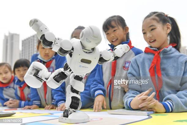 The students are watching the robots doing Tai Chi at the 6th science and technology innovation education festival on 22th November, 2020 in...