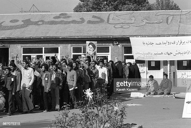 The 'Students Following The Imam Khomeini Line' who hold the American hostages captive inside the embassy chant antiUS slogans after prayers in the...