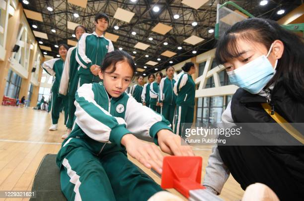 The students were taking the sit forward flexion test. Guiyang City, Guizhou Province, China, October 28, 2020.- PHOTOGRAPH BY Costfoto / Barcroft...