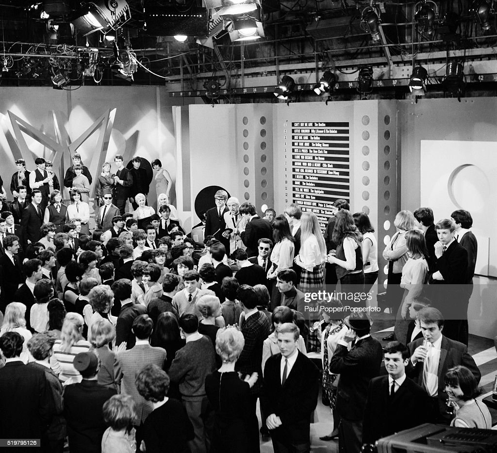 The studio audience at Dickenson Road in Manchester, with Jimmy Savile presenting an edition of the BBC television programme 'Top of the Pops', 25th March 1964.