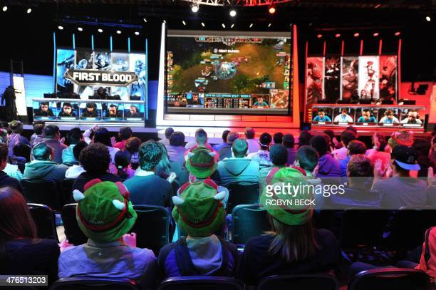 The studio audience watches a match between professional Team Curse and Cloud 9 during the League of Legends North American Championship Series...