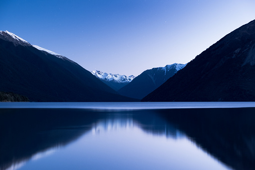 The stunning reflection of the alps mountain on the lake after sunset. St Arnaud, Nelson Lakes National Park. 1060441766