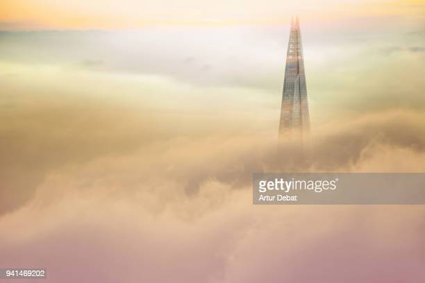 the stunning shard tower in city of london emerging from the clouds. - international landmark stock pictures, royalty-free photos & images