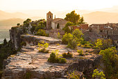 The stunning Siurana town on top of cliff with amazing views at sunset with romantic sky during travel vacations in the Catalonia region.