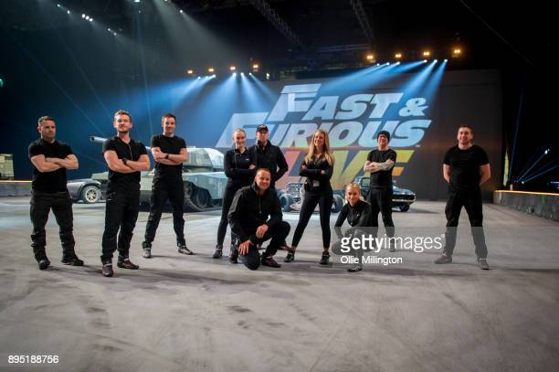 The stunt drivers for the show pose in the arena during the 'Fast Furious Live' technical rehearsal at NEC Arena on December 18 2017 in Birmingham...