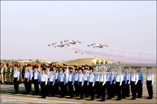 The stunt flying squadron of the Israeli Air Force passes over the young pilots about to receive their wings