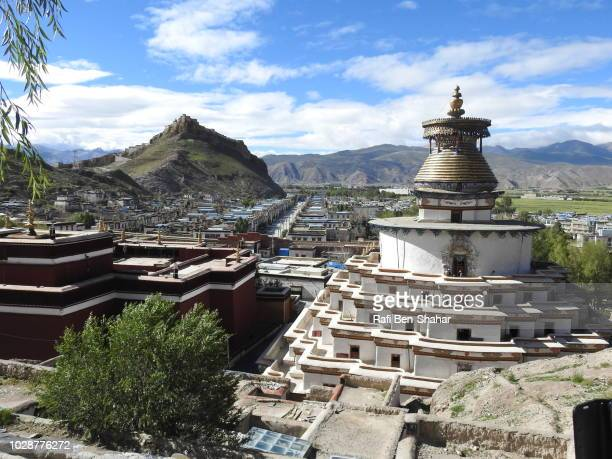 the stupa in the pelkhor chode temple overlooking gyangtse - chode picture stock photos and pictures
