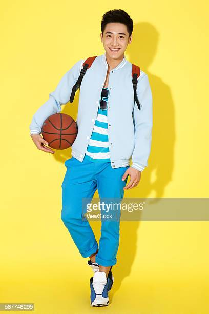 The stylish young man holding a basketball