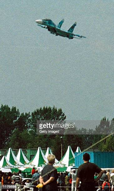 The Su27 fighter plane which crashed into a huge crowd of spectators at an air show flies a few minutes before the tragedy July 27 2002 in Lviv...