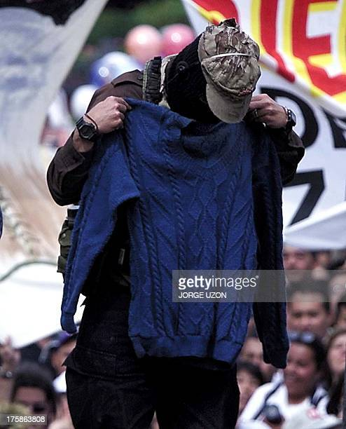 The sub comander Marcos maxim leader of EL Ejercito Zapatista de Liberacion National is trying the swetar from follower as a present in central park...