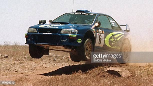 The Subaru Impreza WRC of Finns Juha Kankkunen and Juha Repo flies through the air 26 February during the safari Rally before his car developed...
