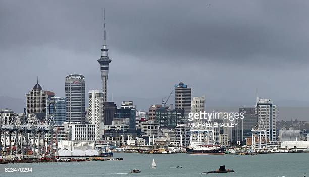 The Submarine HMAS DECHAINEUX from Australia arrives in the Waitemata Harbour as part of the fleet entry to celebrate the Royal New Zealand Navy's...