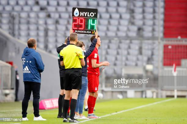 The substitution board is being held up as Ivan Perisic of FC Bayern Muenchen stands on the sideline during the Bundesliga match between FC Bayern...