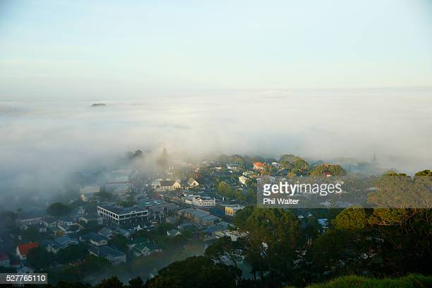 The suburb of Mt Eden struggles to break through a blanket of fog over Auckland City on May 4 2016 in Auckland New Zealand The morning fog disrupted...