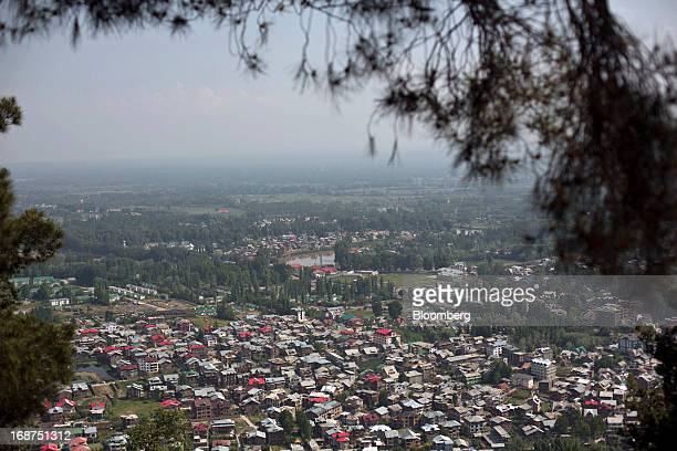The suburb of Sonawur is seen from the Shankaracharya Hill in Srinagar India on Monday May 13 2013 Indian inflation eased to a 41month low in April...