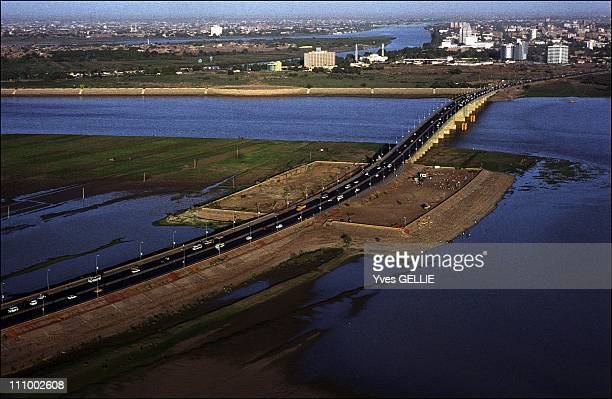 The suburbs of the largest displaced people camp in the Nile Valley in Khartoum Sudan in July 2004 White Nile and Blue Nile in Khartoum