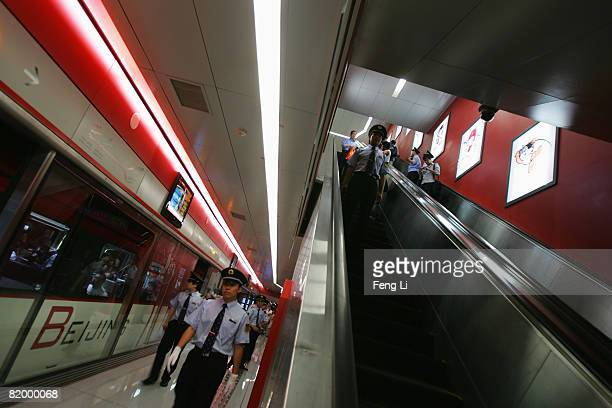 The subway attendants keep order in Dongzhimen station of the new Airport Express on July 19, 2008 in Beijing, China. After seven years of...