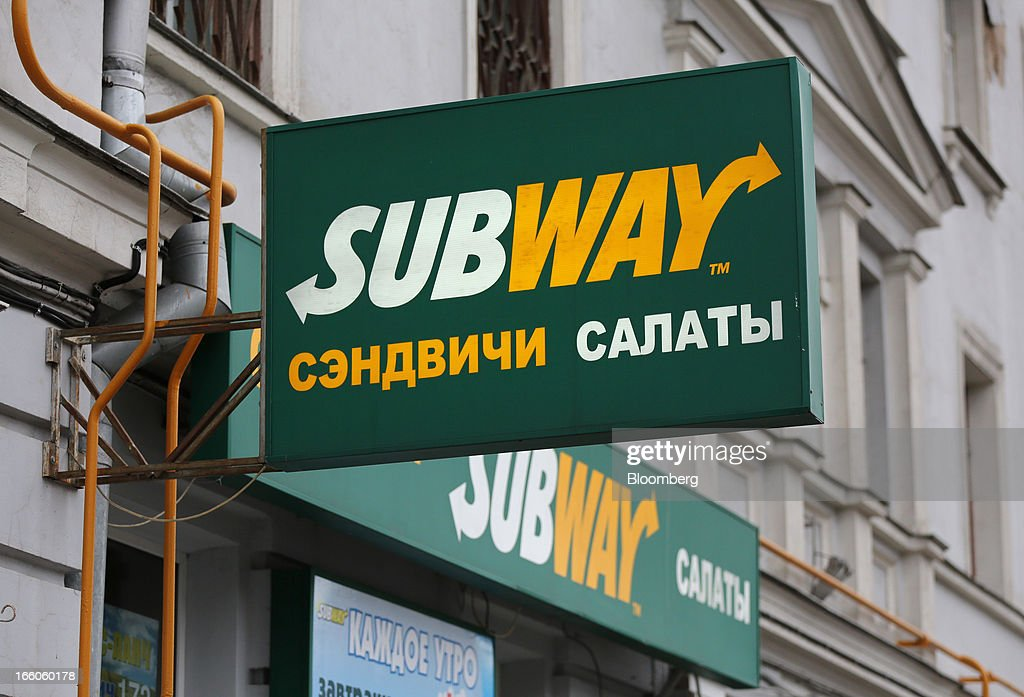The Subway name appears in Russian on a sign outside a Subway fast food restaurant in Moscow, Russia, on Sunday, April 7, 2013. McDonald's, which virtually created the market for burgers and fries in the country and convinced Russians it's OK to eat with their hands, must fend off a growing challenge from rivals Burger King Worldwide Inc., Subway Restaurants, Yum! Brands Inc. and Wendy's Co. Photographer: Andrey Rudakov/Bloomberg via Getty Images