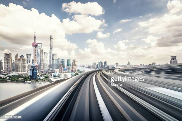 the subway through the bridge with shanghai city skyline background - pudong stock pictures, royalty-free photos & images