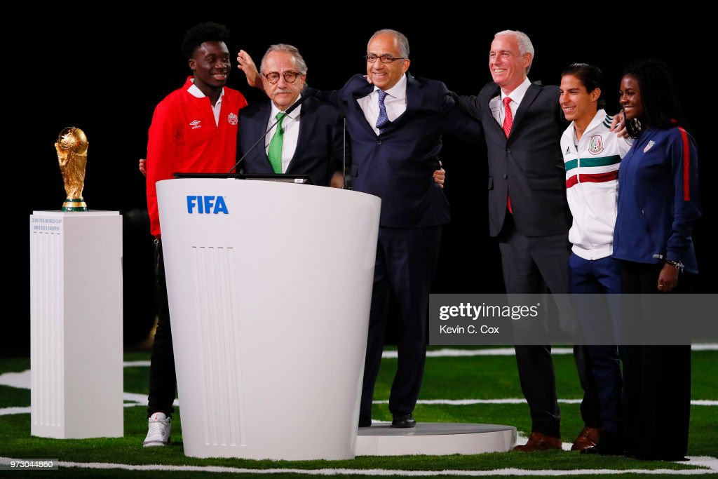 The succesful United 2026 bid (Canada, Mexico, US) officials pose on stage after the announcement of the host for the 2026 FIFA World Cup went to United 2026 bid during the 68th FIFA Congress : Left-Right Alphonso Davies Canadian International, president of the Mexican Football Association Decio de Maria Serrano, president of the United States Football Association Carlos Cordeiro, Steve Reed president of the Canadian Soccer Association, Diego Lainez Mexico U21 International and Brianna Pinto US U20 International at Moscow's Expocentre on June 13, 2018 in Moscow, Russia.