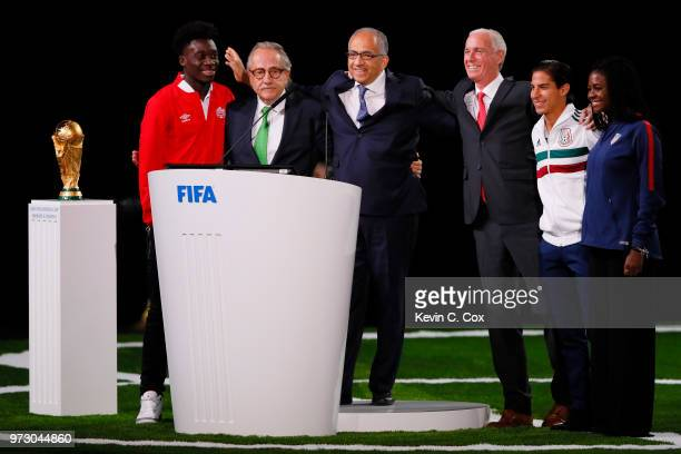 The succesful United 2026 bid officials pose on stage after the announcement of the host for the 2026 FIFA World Cup went to United 2026 bid during...