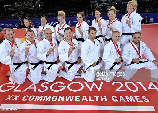 The successful Scottish Judo men and women's teams pose holding their medals on the last day of the judo competition at the Commonwealth Games Judo...