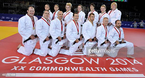 The successful Scottish Judo men and women's teams pose wearing their medals on the last day of the judo competition at the Commonwealth Games Judo...