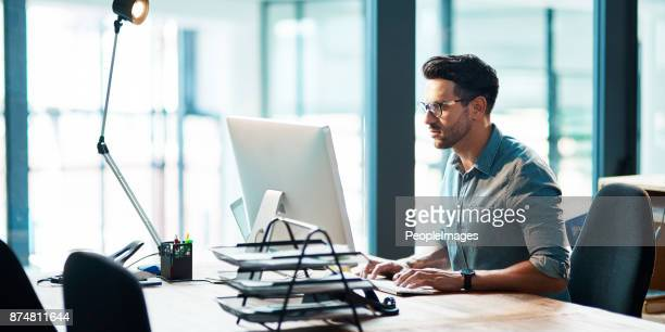 the successful stay consistent - man in office stock photos and pictures