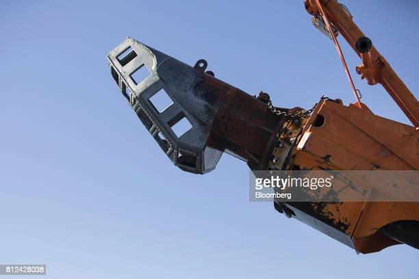 The suction arm of the 'crawler' tractor which is used to suck sediment from the seabed sits aboard the Mafuta diamond mining vessel operated by...