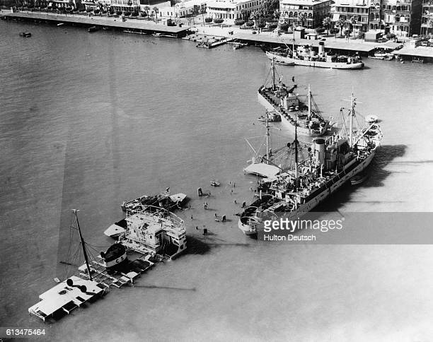 The Suez Crisis. Seen from the air the block ships which have been sunk in the entrance to the Suez Canal at Port Said. At extreme right is one of...